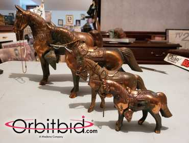 "Lot of 4 copper horses, (1) approx. 11"" wide x 10"" tall, (1) 10"" wide x 8"" tall, (1) 7"" wide x 5..."