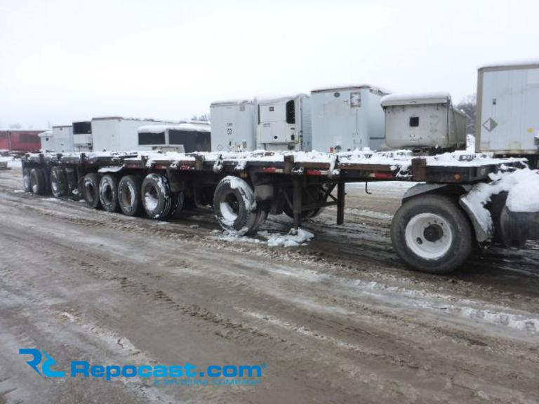 Repocast com® | 1979 Fruehauf B Train Flatbed Log Lead & Pup