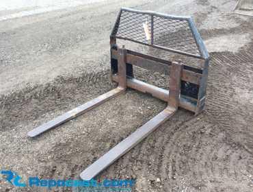 "Repocast com® | CAT 48"" skid steer quick attach forks, used"