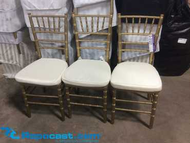 Lot of (75) Gold Color Chiavari Chairs with Seat Pads and chair storage covers, used