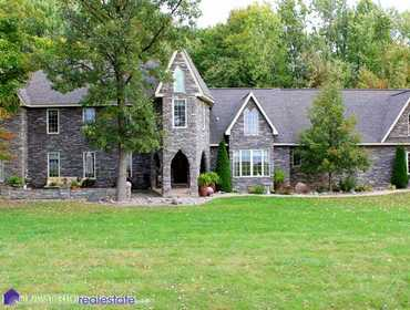 5,000 Sq. Ft. Custom Home with Private Pond on 27 Acres in Swartz Creek, MI
