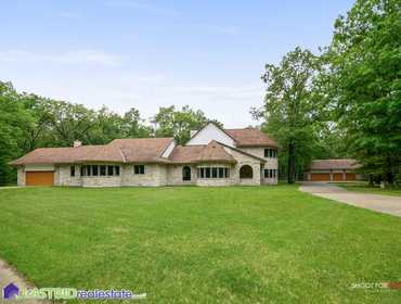 10,700 Sq. Ft. Mansion with Indoor Pool, Hot Tub and Sauna on 10 Acres in Irons, MI