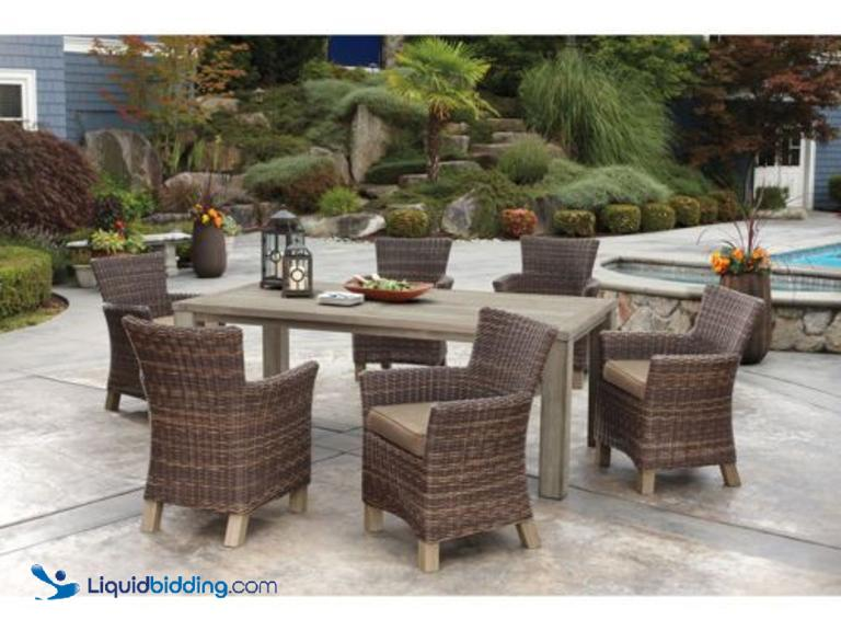 Liquidbidding 7 pc sunbrella teak distressed outdoor for Used patio dining sets
